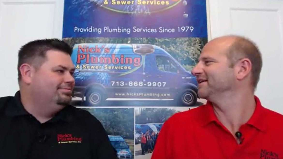 Two of Nick's Plumbing Experts in Houston Smiling and Looking at Each Other