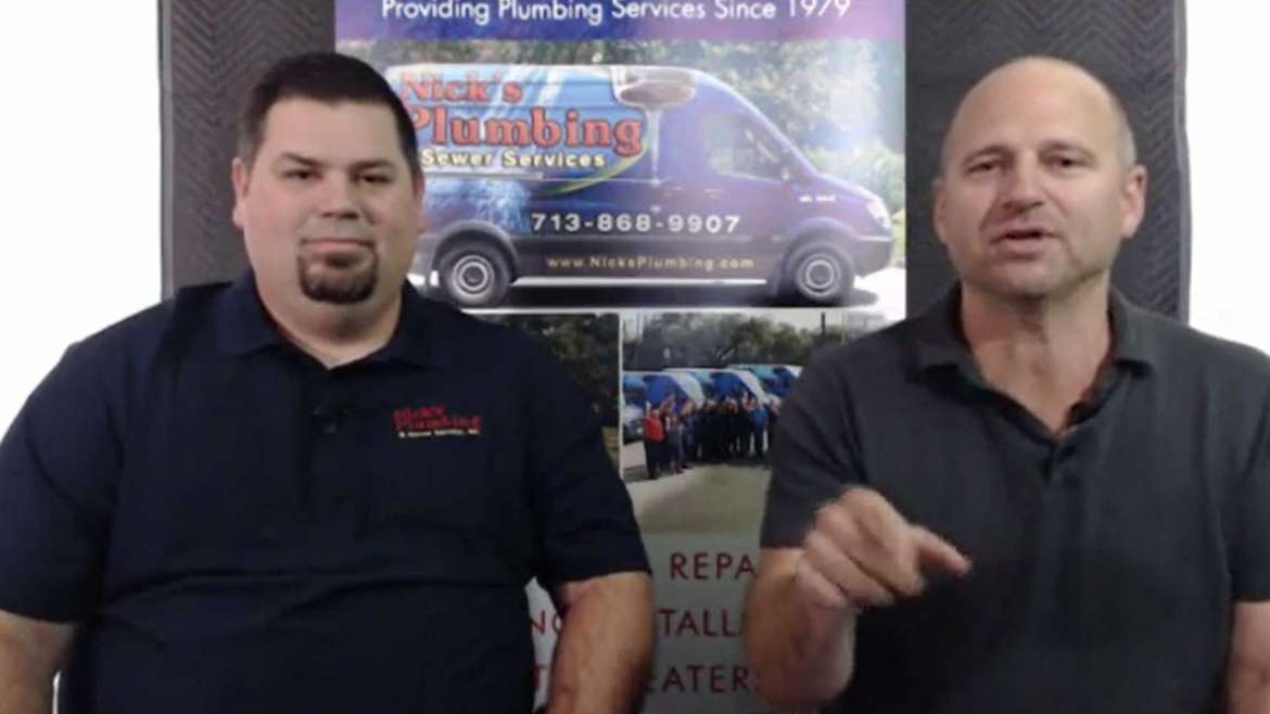 Two of Nick's Plumbing Experts in Houston Talking and Smiling