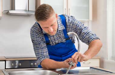 Plumber Fixing a Kitchen Faucet in Houston