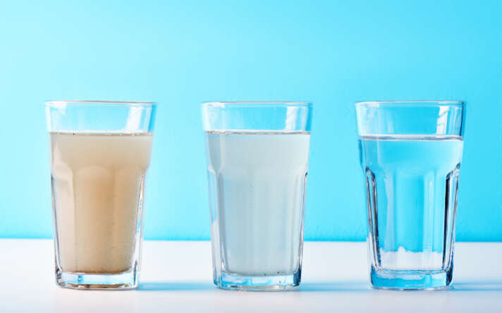 3 glasses with water from dirt to clean