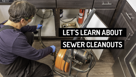 plumber operating sewer cleaning machine